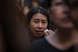October 14, 2016 - Bangkok, Bangkok, Thailand - Thai Royalists and well-wishers cries after the King Bhumibol Adulyade body pass through the crowd as people gather inside Siriraj Hospital for the funeral procession in Bangkok, Thailand on October 14, 2016. Thai King Bhumibol Adulyadej was the world's longest reigning monarch and died at the age of 88 after a long illness since several years, he was the most unifying symbol for Thai people and leaving behind him a divided country under military control. Prime Minister Prayut Chan-o-Cha made a statement that Thailand would have one year period of mourning for HM the King. (Credit Image: © Guillaume Payen/NurPhoto via ZUMA Press)