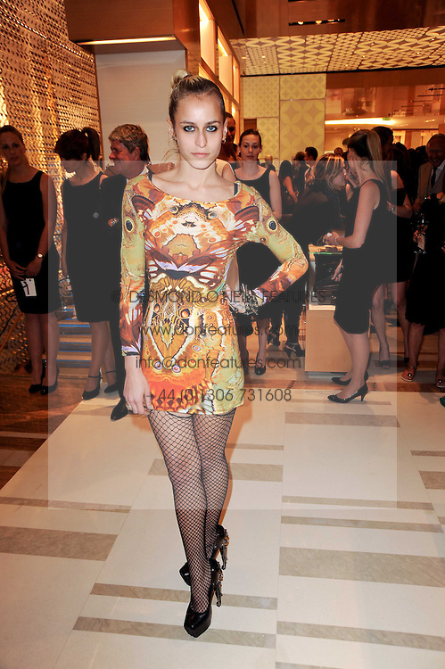 ALICE DELLAL at a party to celebrate the opening of the Louis Vuitton Bond Street Maison, New Bond Street, London on 25th May 2010.