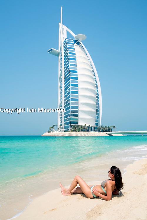 Woman on beach at Burj Al Arab luxury hotel in Dubai United Arab Emirates