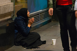 A woman begs on Oxford Street near Marble Arch. Homeless Britons are coming under increasing pressure as a surge of Roma beggars from Romania arrive on the streets of London to take advantage of the generosity of Christmas shoppers. London, December 04 2018.