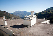 Traditional roofs and chimneys of houses in the village of Capileira, High Alpujarras, Sierra Nevada, Granada province, Spain
