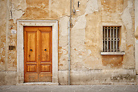 Photo of a rustic Italian residence in San Quirico d'Orcia, Italy.
