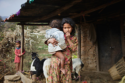 Sumitra, 10, holds 11-month-old Kusum, the family's youngest child, while a neighboring child looks on the background. As the oldest daughter, she bears much of the burden of taking care of her younger siblings. <br /> <br /> Niruta and Durga were married 9 years ago, when they were just 14 and 16 years old in the Kagati village of Nepal. The 2015 earthquakes devastated Nepal and left girls and women in an increasingly vulnerable position, leading experts to believe child marriage rates will increase over the coming years.