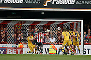 Scott Hogan of Brentford scoring his teams 3rd goal. Skybet football league championship match, Brentford  v Fulham at Griffin Park in London on Saturday 30th April 2016.<br /> pic by Steffan Bowen, Andrew Orchard sports photography.
