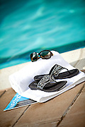 Sandals And Sunglasses At The Pool