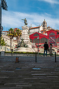Portugal, Porto, Ribeira, Jardim do Infante Dom Henrique, Henry the Navigator statue and Mercado Ferreira Borges