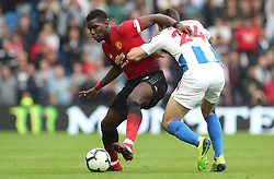 Manchester United's Paul Pogba (left0 and Brighton & Hove Albion's Davy Propper (right) battle for the ball during the Premier League match at the AMEX Stadium, Brighton.
