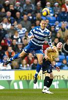 Photo: Gareth Davies.<br />Reading v Everton. The Barclays Premiership. 23/12/2006.<br />Reading's Ivar Ingimarsson (L) out jumps Everton's Andrew Johnson (R).