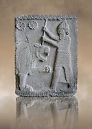 Relief panels depicting a lion hunt found in the palace district in the ruins of Coba Höyük, also known as Sakçe Gözü or Sakçagözü, archaeological site in southeastern Anatolia, Turkey.  Warriors are fighting with the lion from a chariot and on foot wearing armour . Basalt to 750 BC, The Pergamon Museum, Berlin inv no VA 971