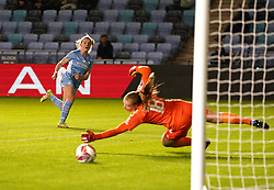 Manchester City's Lauren Hemp (left) sees her shot saved by Everton goalkeeper Courtney Brosnan during the FA Women's League Cup Group B match at the Manchester City Academy Stadium. Picture date: Wednesday October 13, 2021.