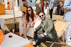OLIVIA GRANT and DIEGO BIVERO-VOLPE at the Veuve Clicquot Gold Cup, Cowdray Park, Midhurst, West Sussex on 21st July 2013.