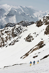Alps mountains skiers cross-country winter