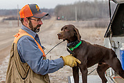 John Zeman and his German Shorthair, Willy, get ready to hunt pheasants on a Minnesota public hunting area.