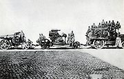Austrian artillery:  Siege gun made up of motorised tractor, right, the mounting which would be placed in a concrete base, centre, and the gun, left.  The gun crew of upwards of 20 men and an officer are also shown.