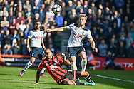 Tottenham Hotspur Midfielder, Eric Dier (15) tackles AFC Bournemouth Forward, Callum Wilson (13) during the Premier League match between Bournemouth and Tottenham Hotspur at the Vitality Stadium, Bournemouth, England on 22 October 2016. Photo by Adam Rivers.