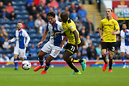 Ben Marshall of Blackburn Rovers and Lloyd Dyer of Burton Albion battle for the ball during the EFL Sky Bet Championship match between Blackburn Rovers and Burton Albion at Ewood Park, Blackburn, England on 20 August 2016. Photo by Simon Brady.