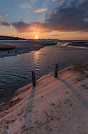 A cold day in Brewster ends with the sun setting over Paine's Creek.