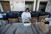 Sorting aerosol cans, solvents and cleaning containers. S.A.F.E  Collection Center, Sun Valley, Bureau of Sanitation for the City of Los Angeles, California, USA
