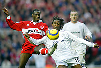 7/11/2004 - FA Barclayship Premiership - Middlesbrough v Bolton Wanderers - The Riverside Stadium<br />Middlesbrough's Joseph-Desire Job outstretches a leg to get the ball off Bolton Wanderers' Ricardo Gardner<br />Photo:Jed Leicester/Back Page Images