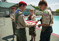The boy scouts prepare to raise the American flag up the flagpole during the 70th Anniversary celebration of the Kiwanis Pool in St. Johnsbury Vermont.  Karen Bobotas / for Kiwanis International