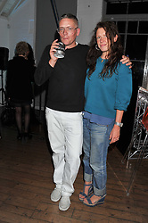 GILES DEACON and KATIE GRAND at a party for Giles Deacon hosted by Mercedes Benz held at Elms Lesters Painting Rooms, Flitcroft Street, London WC2 on 19th September 2011.