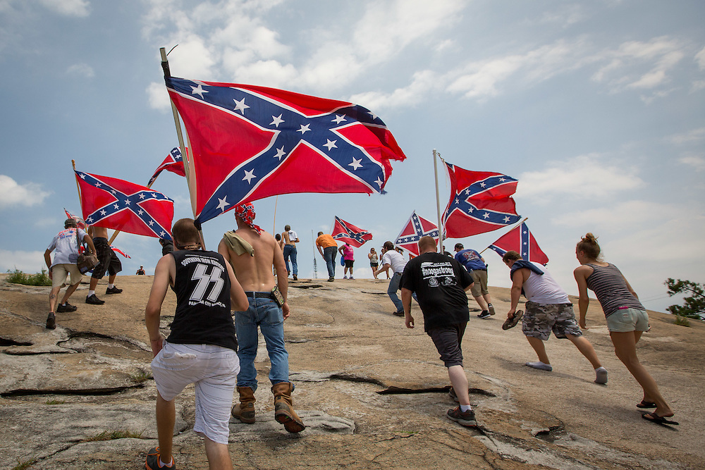 People participating in Confederate flag rally march up Stone Mountain on Saturday, Aug. 1, 2015. Photo by Kevin D. Liles/kevindliles.com