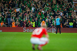 CARDIFF, WALES - Monday, October 9, 2017: Republic of Ireland's supporters celebrate after watching their side secure a 1-0 victory during the 2018 FIFA World Cup Qualifying Group D match between Wales and Republic of Ireland at the Cardiff City Stadium. (Pic by Paul Greenwood/Propaganda)
