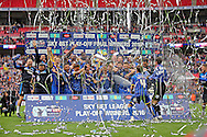AFC Wimbledon defender Barry Fuller (2) lifting the trophy  during the Sky Bet League 2 play off final match between AFC Wimbledon and Plymouth Argyle at Wembley Stadium, London, England on 30 May 2016.