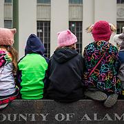 Kids watch the Women's March in Oakland, CA, January 21, 2017.