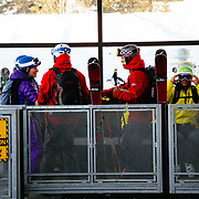 Powder 8 Competition competitors wait for the tram at JHMR.