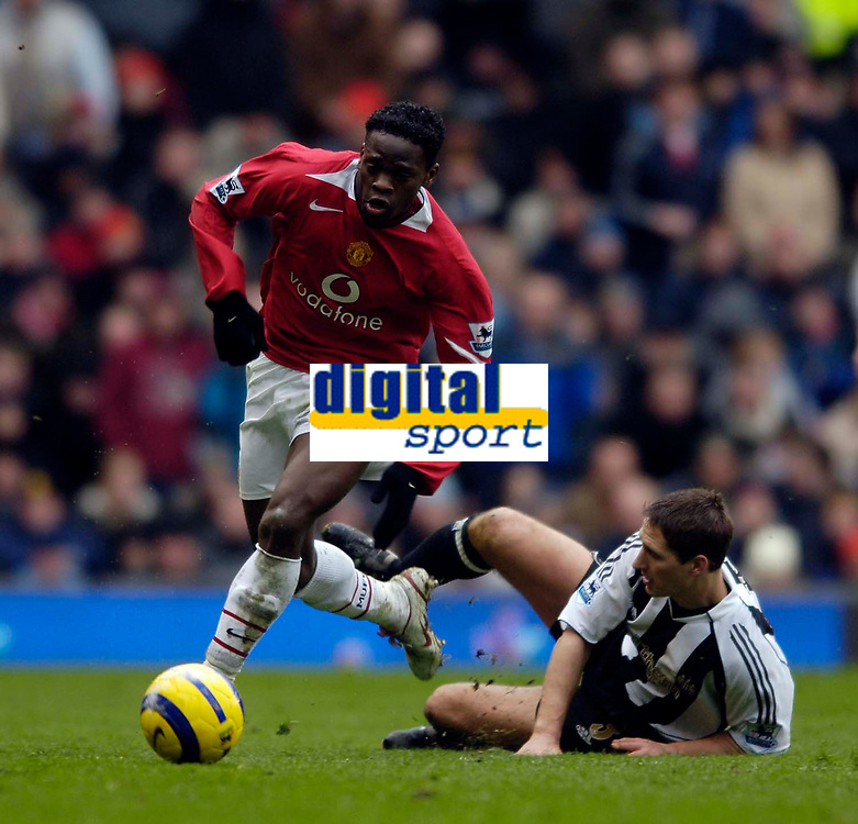 Photo: Jed Wee.<br /> Manchester United v Newcastle United. The Barclays Premiership. 12/03/2006.<br /> <br /> Manchester United's Louis Saha (L) leaves Newcastle's Robbie Elliott in his wake.