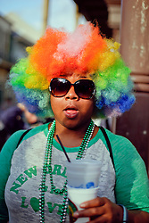 31 January 2016. New Orleans, Louisiana.<br /> Mardi Gras Dog Parade. A spectator in a colorful wig at the Mystic Krewe of Barkus as the parade winds its way around the French Quarter with dogs and their owners dressed up for this year's theme, 'From the Doghouse to the Whitehouse.' <br /> Photo©; Charlie Varley/varleypix.com