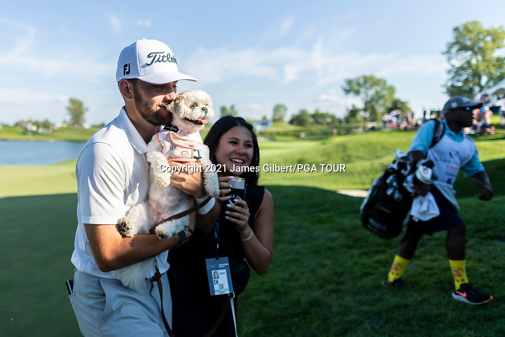 NEWBURGH, IN - SEPTEMBER 05: Hayden Buckley and his girlfriend Feleysa Nguyen walk off the 18th green with their dog after the final round of the Korn Ferry Tour Championship presented by United Leasing and Financing at Victoria National Golf Club on September 5, 2021 in Newburgh, Indiana. (Photo by James Gilbert/PGA TOUR via Getty Images)