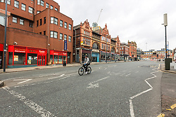 © Licensed to London News Pictures. 17/03/2020. Leeds UK. Streets in Leeds city centre are almost empty this morning after yesterdays announcement that people should work from home & everyone should avoid pubs, clubs & restaurants. Photo credit: Andrew McCaren/LNP