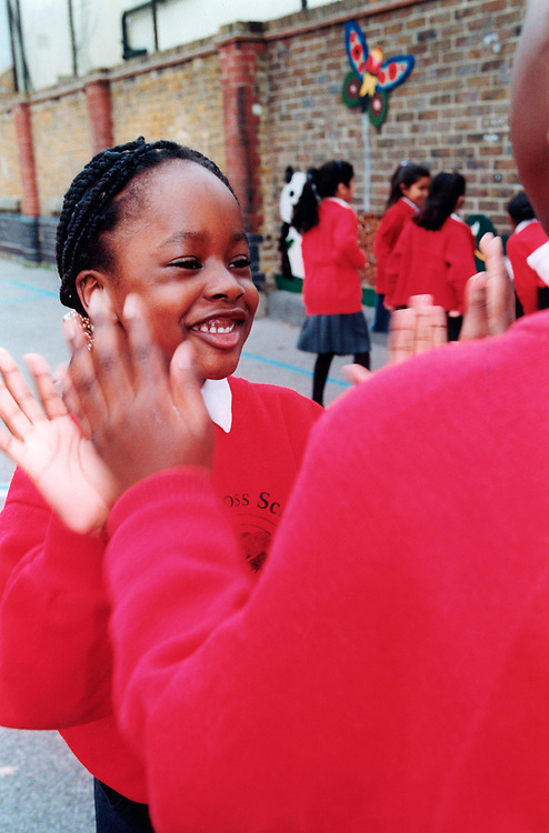 Children in playground at primary school London UK