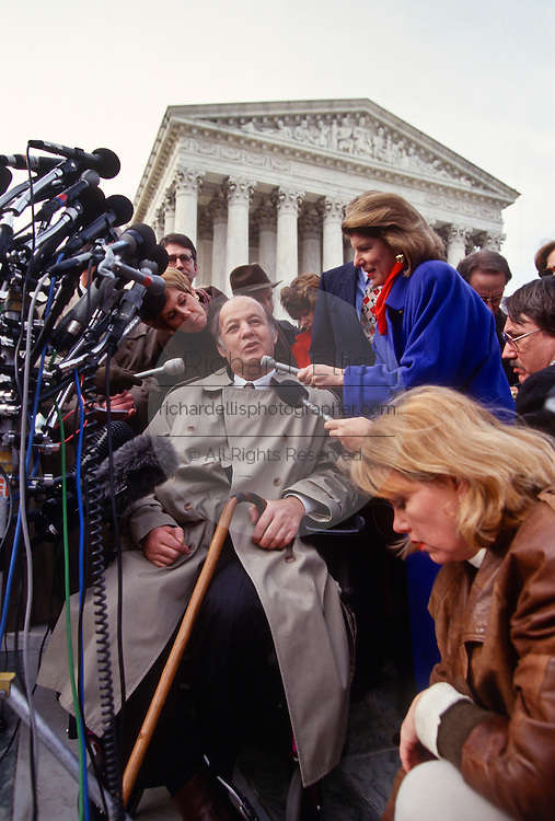 Former White House press secretary James Brady talks to the media outside the Supreme Court in Washington Tuesday, Dec. 3, 1996, after a hearing to discuss the Brady gun-control law. The measure is named after Brady, who was seriously wounded in the 1981 assassination attempt on President Reagan.