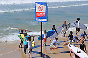 Israel, Haifa, summer activity on the beach Surfers enter the water