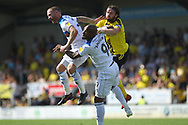 Calvin Andrew and Matty Done in an aerial battle during the EFL Sky Bet League 1 match between Burton Albion and Rochdale at the Pirelli Stadium, Burton upon Trent, England on 4 August 2018.