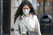 A girl wearing Face Mask walks alongside a street near Oxford Circus in central London on Monday, May 11, 2020 - U.K. Prime Minister Boris Johnson fleshed out his plan for lifting the U.K. lockdown in Parliament as he seeks to get more people back to work, even as resistance from politicians and labour unions laid bare the hurdles facing the government as it seeks to kickstart the economy. (Photo/ Vudi Xhymshiti)