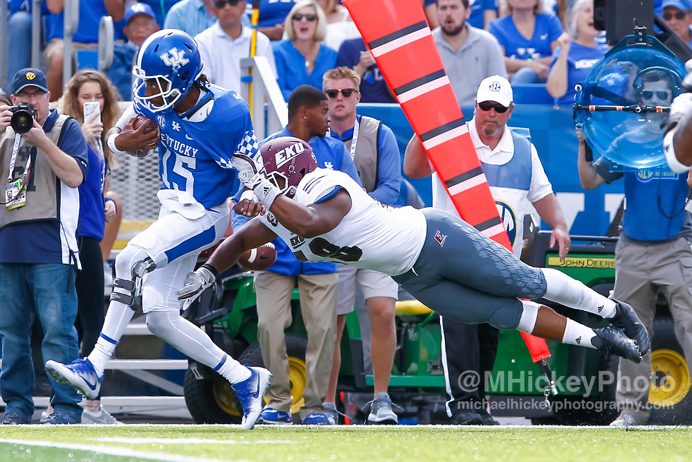LEXINGTON, KY - SEPTEMBER 09: Stephen Johnson #15 of the Kentucky Wildcats runs the ball as Brentton Ervin #58 of the Eastern Kentucky Colonels attempts the tackle at Kroger Field on September 9, 2017 in Lexington, Kentucky. (Photo by Michael Hickey/Getty Images) *** Local Caption *** Stephen Johnson; Brentton Ervin