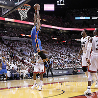 21 June 2012: Oklahoma City Thunder point guard Russell Westbrook (0) goes for the dunk during the Miami Heat 121-106 victory over the Oklahoma City Thunder, in Game 5 of the 2012 NBA Finals, at the AmericanAirlinesArena, Miami, Florida, USA. The Miami Heat wins the series 4-1.