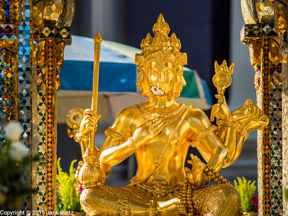 19 AUGUST 2015 - BANGKOK, THAILAND: The Four Faced Brahma in Erawan Shrine was damaged by shrapnel in the bomb attack on the shrine. Erawan Shrine in Bangkok reopened Wednesday morning after more than 20 people were killed and more than 100 injured in a bombing at the shrine Monday, August 17, 2015. The shrine is a popular tourist attraction in the center of Bangkok's high end shopping district and is an important religious site for Thais. No one has claimed responsibility for the bombing.      PHOTO BY JACK KURTZ