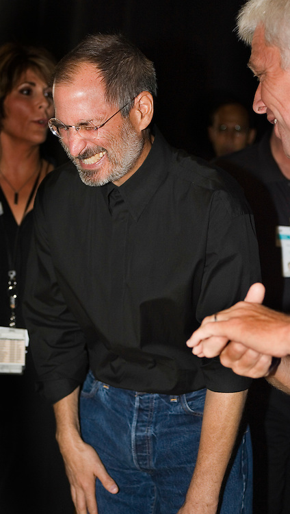 Apple Computer CEO Steve Jobs laughs following an Apple event in San Francisco, Tuesday, Sept. 12, 2006. Apple Computer launched its long-awaited online movie service Tuesday with minimal participation from Hollywood and showed off a device that will make it easier for consumers to watch the videos on television.  Photo by Kim Kulish