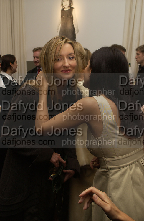 Natasha  McElhone and Yasmin Mills. A photo exhibition in support of Facing the World <br />Hosts: Christopher Bailey with Eliane Fattal, Yasmin Mills, Emily Oppenheimer Turner, Catherine Prevost and Elizabeth Saltzman Walker.  Burberry, 18 - 22 Haymarket, SW1  .  9 November 2005. ONE TIME USE ONLY - DO NOT ARCHIVE © Copyright Photograph by Dafydd Jones 66 Stockwell Park Rd. London SW9 0DA Tel 020 7733 0108 www.dafjones.com