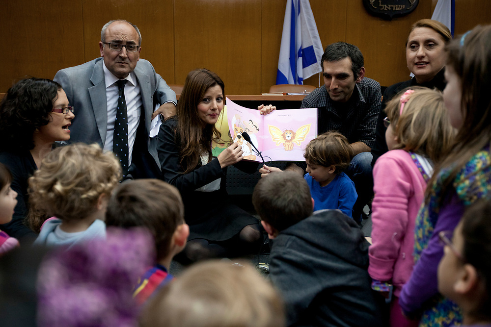 Israeli Parliament member Orly Levy-Abekasis (C) of the right-wing party Yisrael Beiteinu reads a story to children at the Knesset, Israel's parliament in Jerusalem, on January 17, 2012, during an event supporting a law amendment that would allow for free education to children above the age of three.
