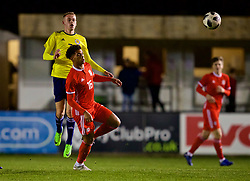 RHYL, WALES - Wednesday, November 14, 2018: Wales' Christian Norton and Scotland's Zak Rudden during the UEFA Under-19 Championship 2019 Qualifying Group 4 match between Wales and Scotland at Belle Vue. (Pic by Paul Greenwood/Propaganda)