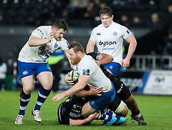 Bath Rugby's Ross Batty is tackled by Ospreys' Ma'afu Fia<br /> <br /> Photographer Simon King/Replay Images<br /> <br /> Anglo-Welsh Cup Round 4 - Ospreys v Bath Rugby - Friday 2nd February 2018 - Liberty Stadium - Swansea<br /> <br /> World Copyright © Replay Images . All rights reserved. info@replayimages.co.uk - http://replayimages.co.uk