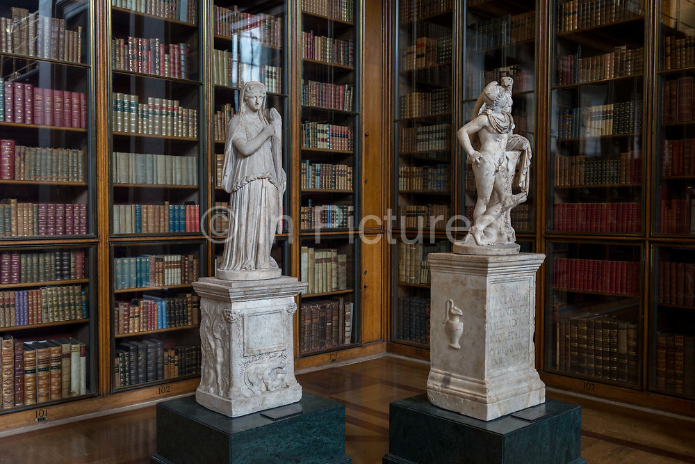 2nd century Roman copies from Greek originals of Demeter holding a torch L and Gannymede with the eagle of Zeus R, in the Enlightenment Gallery of the British Museum, on 11th April 2018, in London, England.