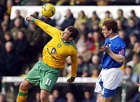 Photo: Chris Ratcliffe.<br /> Norwich City v Ipswich Town. Coca Cola Championship. 05/02/2006.<br /> Jonatan Johnasson of Norwich tussles with Richard Naylor  of Ipswich