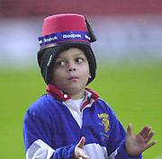Watford,  Hertfordshire, Parker Pen  Rugby Cup, 12th December 2002, [Mandatory Credit: Peter Spurrier/Intersport Images],<br /> Parker Pen - European Cup - Vicarage Road - <br /> Saracens v Colomiers<br /> 'Two hats are better than One' Young fan waiting for the teams to merge from the tunnel.